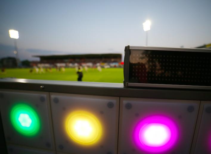 Point lumineux du mur digital avec stade en arrière plan