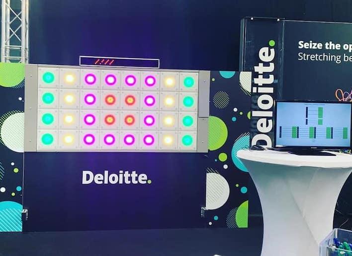 Mon Mur Digital à l'image de Deloitte lors d'un salon / congrès